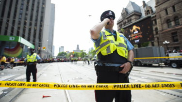 Police secure the scene after shots were fired at the parade.
