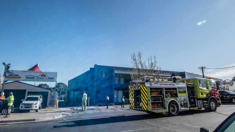 Firefighters outside Seven Miles Coffee Roasters in Fyshwick on Thursday morning.
