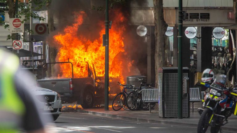 The moment the car burst into flames on Bourke Street.