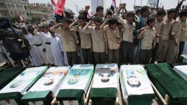 Yemeni people attending the funeral of victims of a Saudi-led airstrike in August.