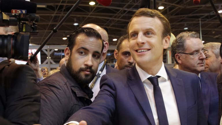 Emmanuel Macron, center, flanked by his bodyguard, Alexandre Benalla, left, visits the Agriculture Fair in Paris last year.