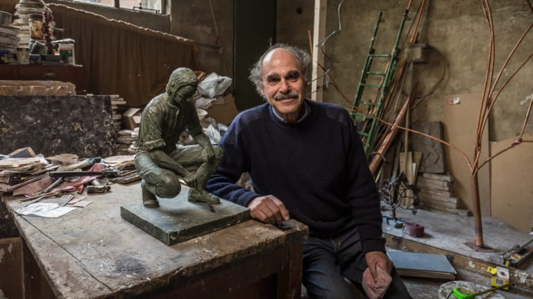 Sculptor Michael Meszaros with a maquette of his 1978 sculpture of John Pascoe Fawkner.