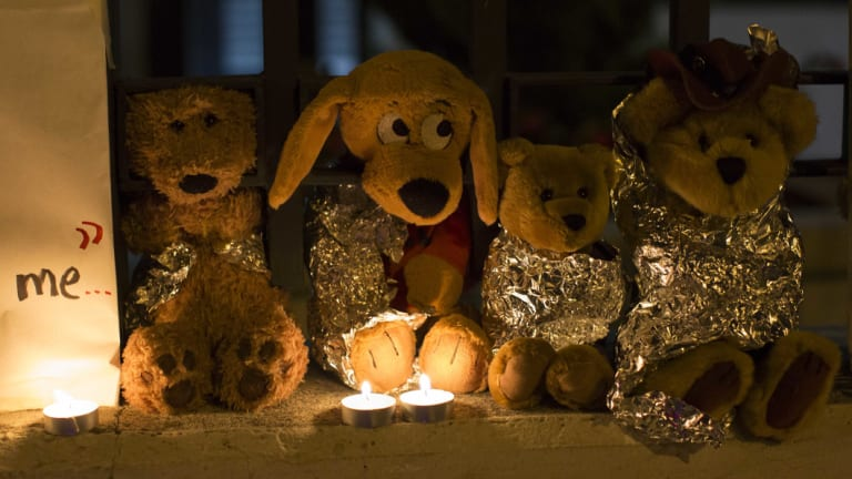 Stuffed toys wrapped in aluminium foil outside the US embassy in Guatemala City represent migrant children separated from their families.