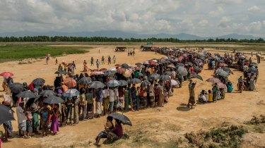 Refugees line up to register near the Nayapara refugee camp in Cox's Bazar, Bangladesh.