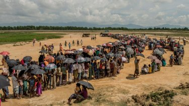 Refugees line up to register near the Nayapara refugee camp in Cox's Bazar, Bangladesh.