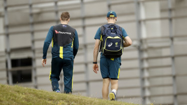 Walk on:  Steve Smith, left, and Cameron Bancroft talk at a training in Southampton on Monday and, inset,  facing the media in South Africa. Photos: Getty Images, AFP