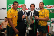 Kurtley Beale, James O'Connor and Quade Cooper with Wallabies coach Robbie Deans after winning the 2011 Tri Nations trophy.