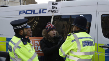 Police speak to a Leave campaigner outside Parliament in London on Tuesday.
