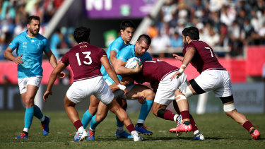 Nothing left: Uruguay fought an uphill battle against Georgia, four days after their upset win over Fiji.
