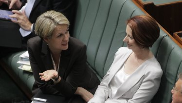 Tanya Plibersek and Julia Gillard during question time in Parliament in 2012.