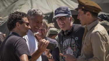Directors Grant Heslov, George Clooney, Ellen Kuras, star Christopher Abbott with Davies on set.