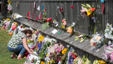 A floral tribute on the fence of the Christchurch Botanic Gardens.