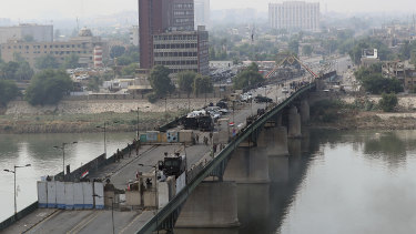Security forces fire tear gas and close the bridge leading to the Green Zone during a demonstration in Baghdad, Iraq.