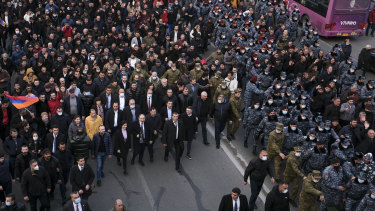 Armenian Prime Minister Nikol Pashinyan, centre front left carrying a megaphone, walks with his wife Anna Akobyan and supporters surrounded by bodyguards in Yerevan, Armenia.