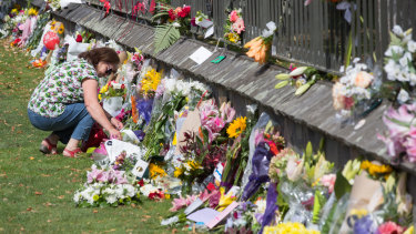 A floral tribute on the fence of the Christchurch Botanic Gardens