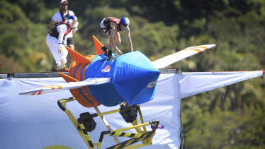 Contestants soar through the Red Bull Flugtag event on homemade contraptions.