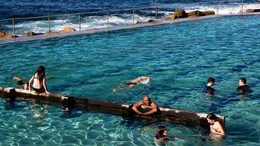 Swimmers enjoy the winter sunshine at Bronte Pool, Sydney.