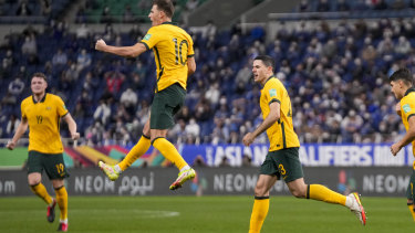 Australia's Ajdin Hrustic leaps in the air as he celebrates after scoring his team's first goal.