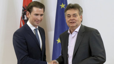 Sebastian Kurz, left, head of the Austrian People's Party, shakes hands on a coalition deal with Werner Kogler, head of the Austrian Greens. The deal will likely see Kurz back at the helm.