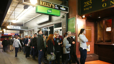 Punters line up to enter Newtown bar Kelly's on King.