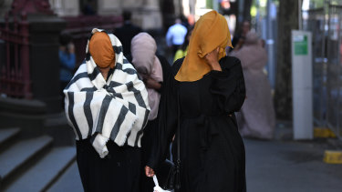 Asha Ali (right), sister of Ali Khalif Shire Ali, departs the Supreme Court of Victoria in Melbourne on Thursday.