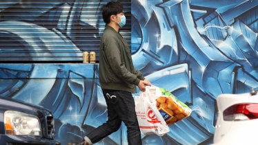 A shopper wearing a face mask in Melbourne's CBD.
