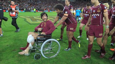 Johnathan Thurston was part of the Maroons' celebrations, despite injuring his knee.