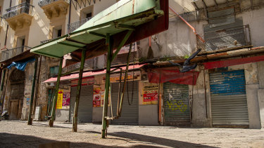 Stalls stand closed at the open-air market Il Capo in Palermo, Italy.
