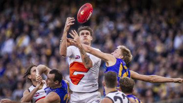 Eyes on the prize: GWS forward Rory Lobb rises above the pack.