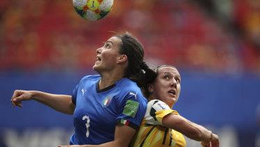 Australia's Lisa De Vanna, right, challenges Italy's Alia Guagni, left.