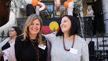 Lou's Place general manager Nicole Yade, right, and the organisation's chair Alexa Haslingden celebrate 20 years of the refuge in 2019.