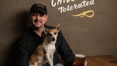 Peter Philip with Jack Russell Quila at his brewery in Camperdown.