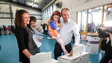 Josh Frydenberg voting in Kooyong with his family.