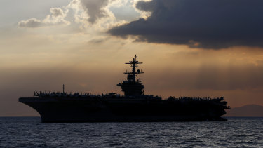 The USS Theodore Roosevelt aircraft carrier, pictured anchored off Manila Bay in 2018.