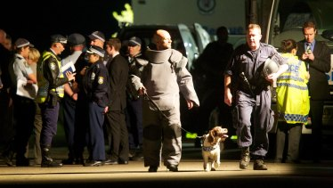 Police including the bomb squad respond to the Mosman home on August 3, 2011.