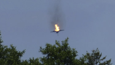 A burning Eurofighter plane crashes down near the village Malchow in northern Germany.