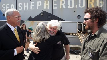 Watson receives a hug after docking in Melbourne's Williamstown following a campaign to stop Japanese whaling.