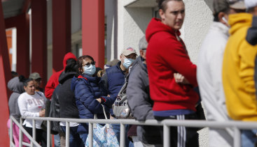 People wait in line to collect their unemployment benefits in Las Vegas.