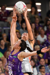 Ashleigh Brazill rises for the Pies.