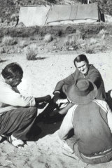 Then prime minister Malcolm Fraser (top) sits in the bed of the Todd River in the Northern Territory speaking to Indigenous locals in April 1978.
