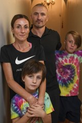 Marathon runner Sinead Diver at her Melbourne home with husband Colin, and sons Eddie, 11, and Dara, 7.