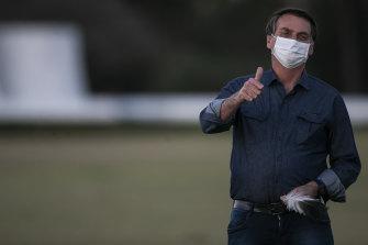 Brazilian President Jair Bolsonaro outside his official residence after testing positive for coronavirus for the second time.