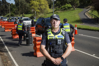 Leading Senior Constable Paul Gosling at the Upper Ferntree Gully vehicle checkpoint on Sunday, its last day of operation.