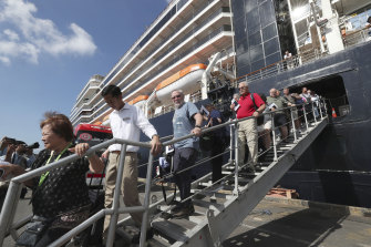 Passengers of the Westerdam disembark at the port of Sihanoukville, Cambodia, on Saturday. There are now concerns many of the passengers may have been infected with the coronavirus.