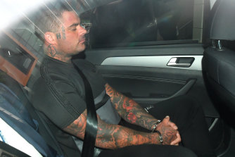 Andrew Heil arrives at the Melbourne Magistrates Court after being charged over a cache of weapons.