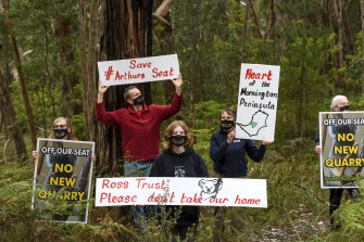 Residents protest against the proposed quarry at Arthurs Seat: Michelle de la Coeur (second from right), her husband Mark Fancett (second from left), and their daughter Alex Fancett, along with Janet and John Stanley (far left and far right).