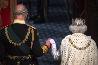 The Queen and Prince Charles attend the State Opening of Parliament.