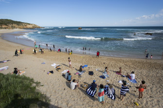 Swimmers and sunbakers were keeping their spacing at Sorrento.