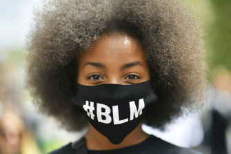 A protestor wearing a face mask to protect against coronavirus, takes part in a Black Lives Matter protest rally in the UK.
