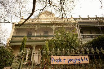 """Messages of support: Signs on the fence at Hambleton House in Albert Park read """"you are remembered"""" and """"People r praying 4 u""""."""